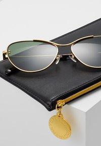 Stella McCartney - Sunglasses - gold/green - 2