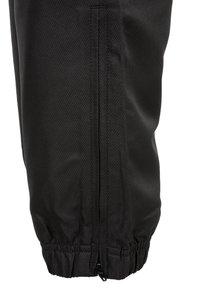 sergio tacchini - CARSON  - Pantalon de survêtement - black/white - 3