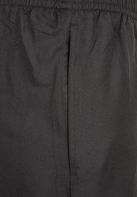 sergio tacchini - CARSON  - Pantalon de survêtement - black/white - 2