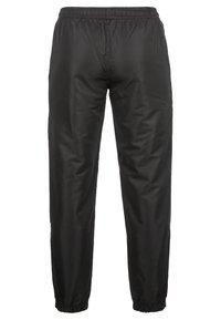 sergio tacchini - CARSON  - Pantalon de survêtement - black/white - 1