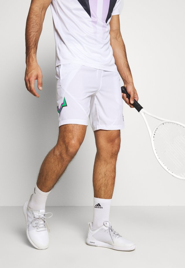 SHORTS - Sports shorts - white/green