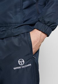 sergio tacchini - CARSON SLIM PANTS - Tracksuit bottoms - navy/white - 4