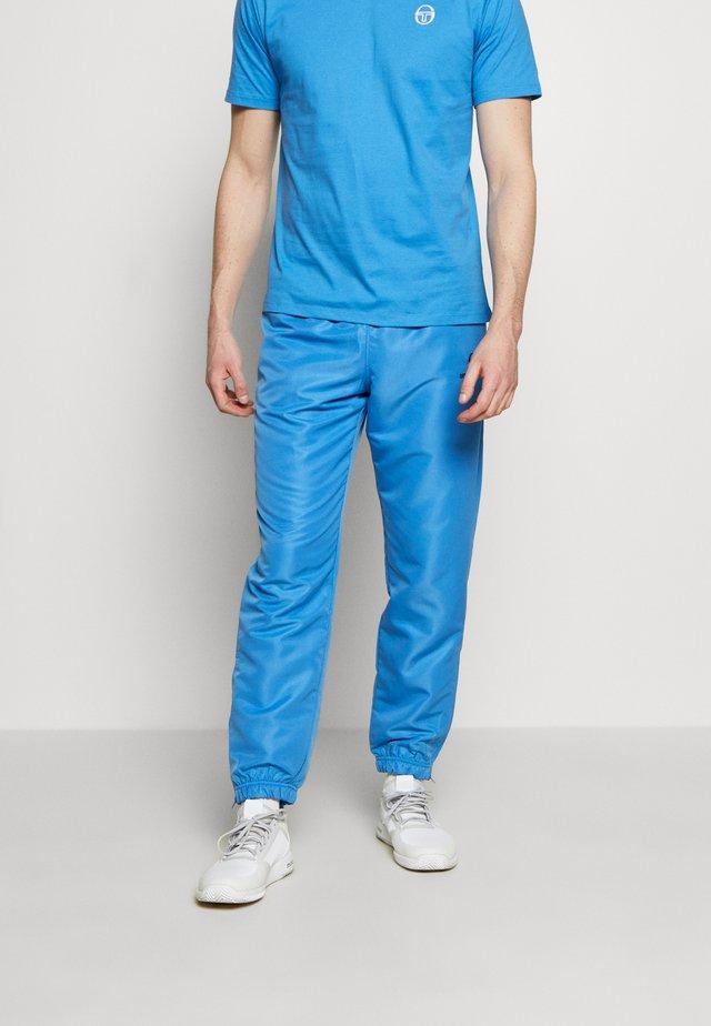 CARSON SLIM PANTS - Spodnie treningowe - campanula/navy