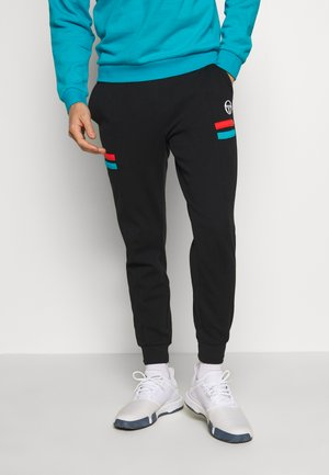 FOREST PANTS - Pantalon de survêtement - black/flash orange