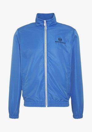 CARSON TRACKTOP - Training jacket - campanula/navy