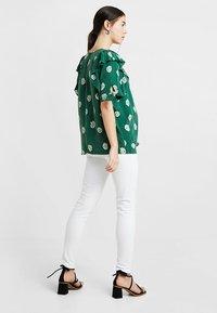 Seraphine - ZAHARA - Jeans slim fit - white - 2