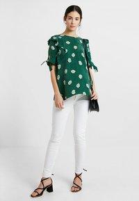 Seraphine - ZAHARA - Jeans slim fit - white - 1