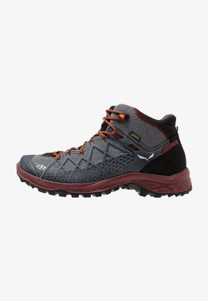 WILD HIKER MID GTX - Outdoorschoenen - black/biking red