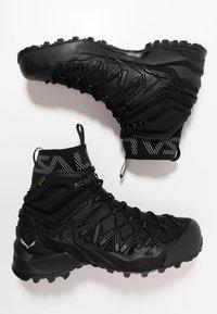 Salewa - WILDFIRE EDGE MID GTX - Hiking shoes - black - 1