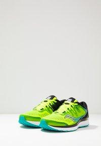 Saucony - GUIDE ISO 2 - Stabilní běžecké boty - citron/black - 2