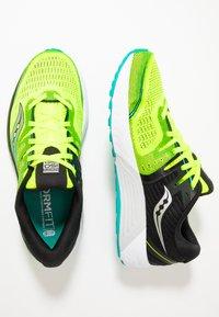 Saucony - GUIDE ISO 2 - Stabilní běžecké boty - citron/black - 1