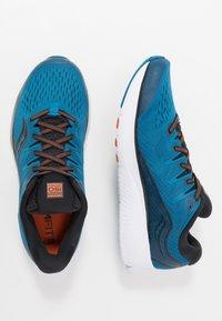 Saucony - RIDE ISO 2 - Obuwie do biegania treningowe - black/blue - 1