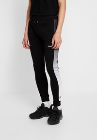 STEREOTYPE - FREQUENCY POLY - Tracksuit bottoms - black - 0