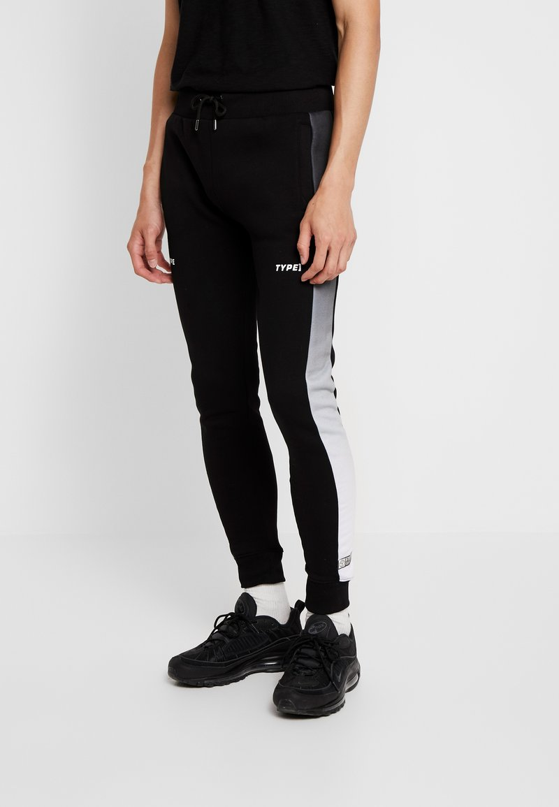 STEREOTYPE - FREQUENCY POLY - Tracksuit bottoms - black