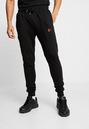 METALIC - Tracksuit bottoms - black