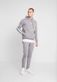 STEREOTYPE - CHROME  - Teplákové kalhoty - grey - 1