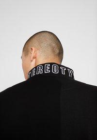 STEREOTYPE - TRANSMIT HALF ZIP - Sweatshirt - black - 7