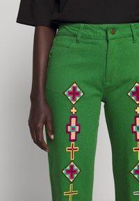 Stieglitz - EVITA PANTS - Flared Jeans - green - 6