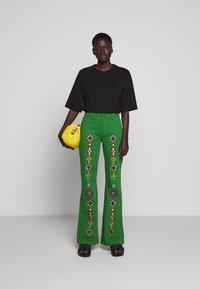 Stieglitz - EVITA PANTS - Flared Jeans - green - 1