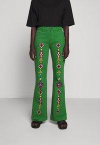 Stieglitz - EVITA PANTS - Flared Jeans - green - 0