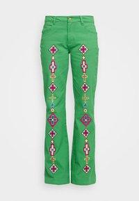 Stieglitz - EVITA PANTS - Flared Jeans - green - 7