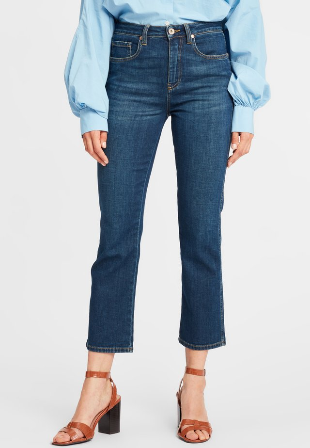 Flared Jeans - dark blue