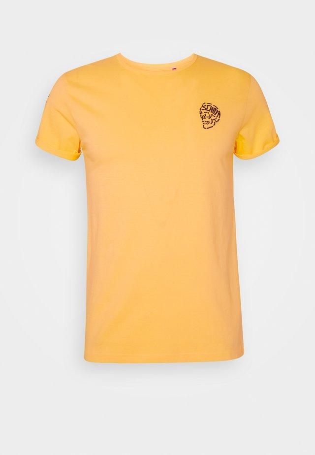 Print T-shirt - ochre