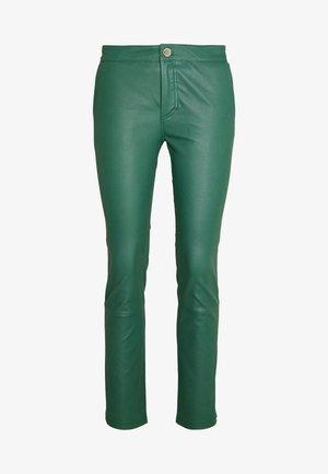 LEYA - Leather trousers - sagebrush