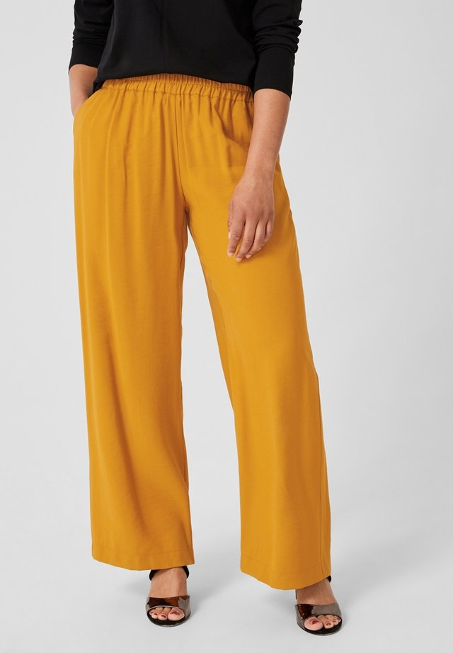 MIT WEBMUSTER - Trousers - yellow