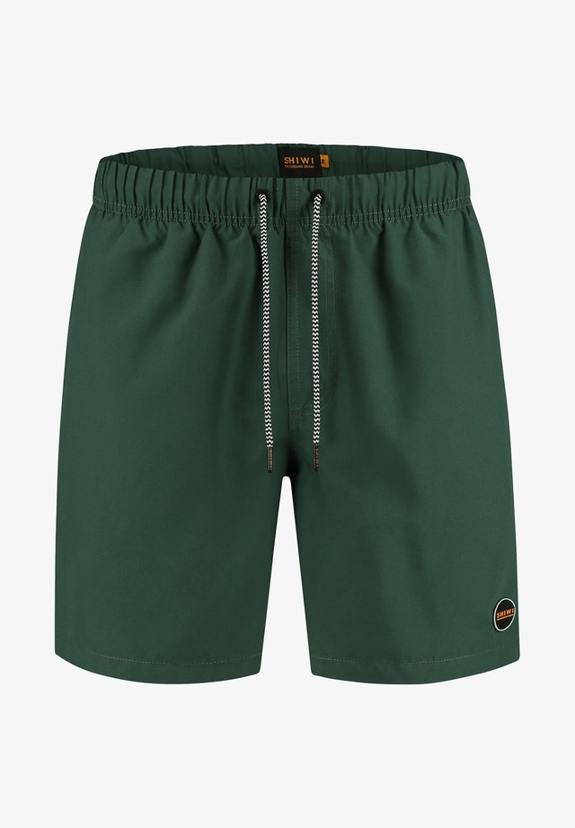 MIKE - Swimming shorts - green