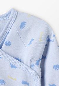 Sanetta - WRAPOVER ALLOVER BABY ZGREEN - Body - light blue - 2