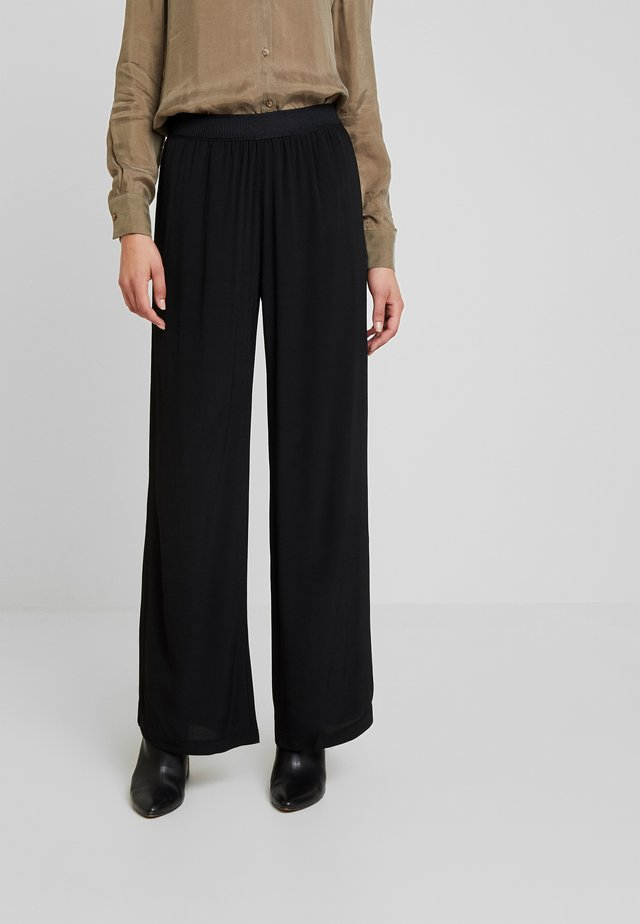 NESSIE  - Pantalon classique - black
