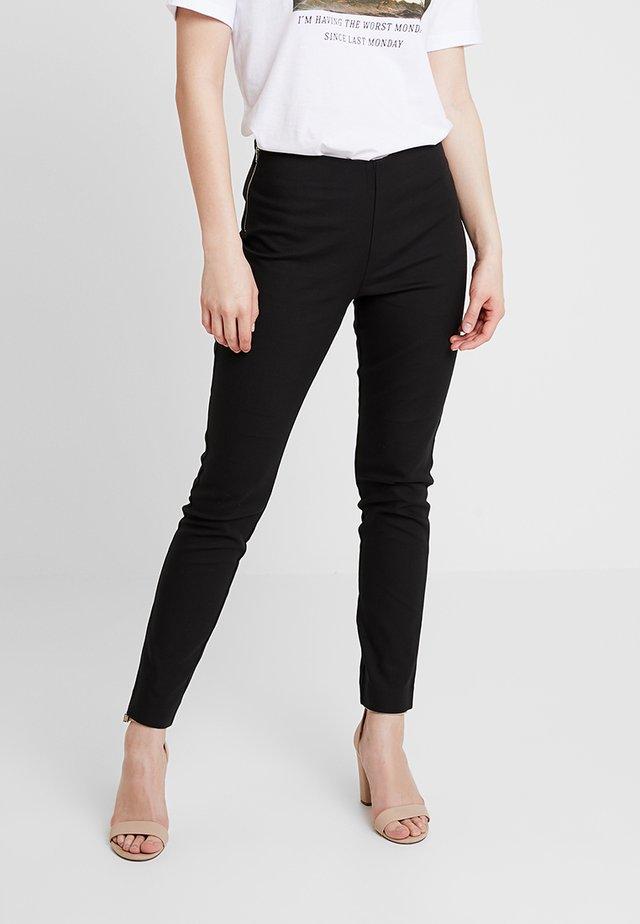 SION PANTS - Trousers - black