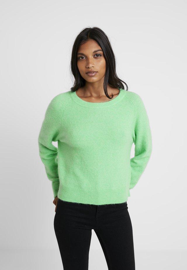 Stickad tröja - irish green