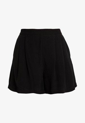 GANDA - Shorts - black