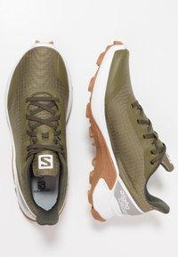 Salomon - ALPHACROSS - Trail running shoes - burnt olive/white - 1