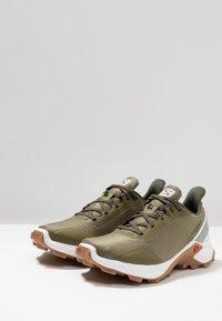 Salomon - ALPHACROSS - Trail running shoes - burnt olive/white - 2