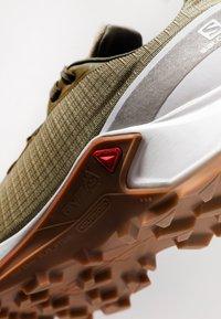 Salomon - ALPHACROSS - Trail running shoes - burnt olive/white - 5