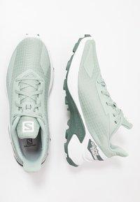 Salomon - ALPHACROSS BLAST - Trail running shoes - aqua gray/white/balsam green - 1