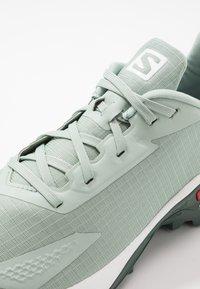 Salomon - ALPHACROSS BLAST - Trail running shoes - aqua gray/white/balsam green - 5