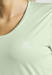 Salomon - AGILE TEE - Print T-shirt - seacrest/white/heather - 4