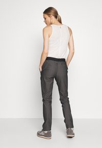 Salomon - WAYFARER TAPERED - Outdoor trousers - black heather - 2