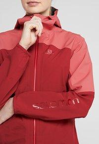 Salomon - OUTLINE  - Hardshell jacket - rio red/garnet rose - 4