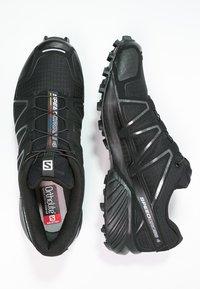 Salomon - SPEEDCROSS 4  - Løpesko for mark - black/black/black metallic - 1