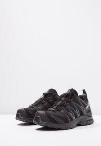 Salomon - XA PRO 3D GTX - Trail running shoes - black/magnet - 2