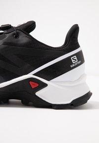 Salomon - SUPERCROSS MEN - Trail running shoes - black/white - 5