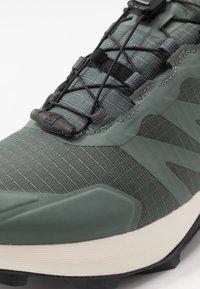 Salomon - SUPERCROSS GTX - Trail running shoes - balsam green/vanilla ice/india ink - 5
