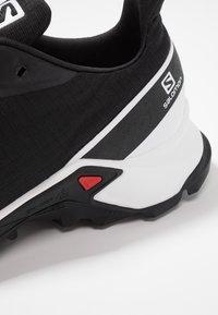 Salomon - ALPHACROSS - Zapatillas de trail running - black/white/monument - 5