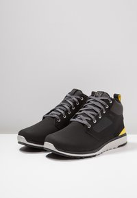 Salomon - UTILITY FREEZE CS WP - Winter boots - black/empire yellow - 2