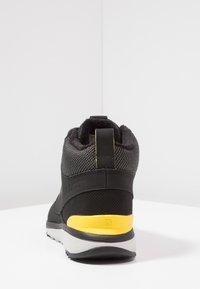 Salomon - UTILITY FREEZE CS WP - Winter boots - black/empire yellow - 3